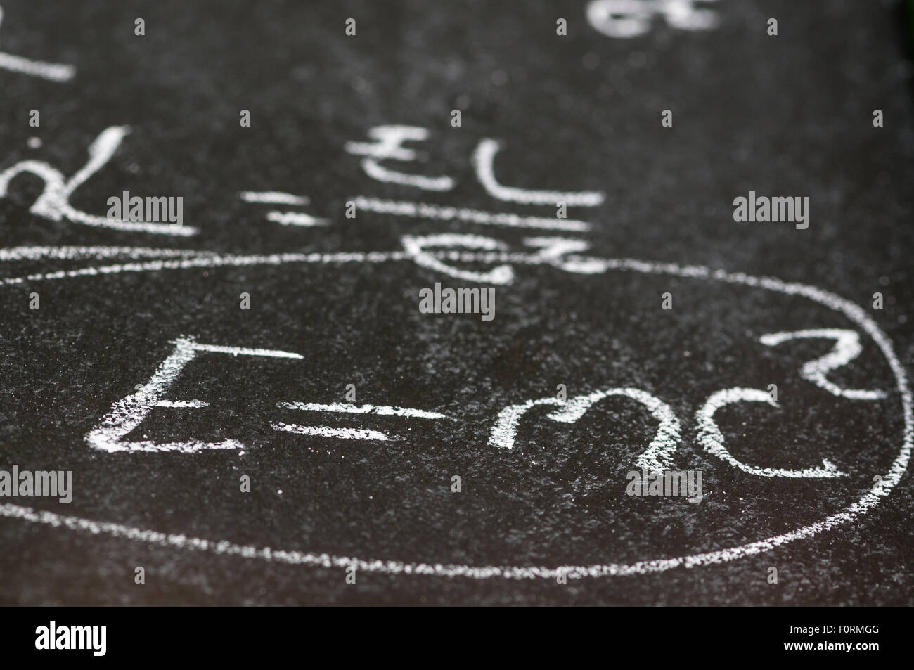 Mathematical derivation of E=mc^2 on a blackboardStock Photo