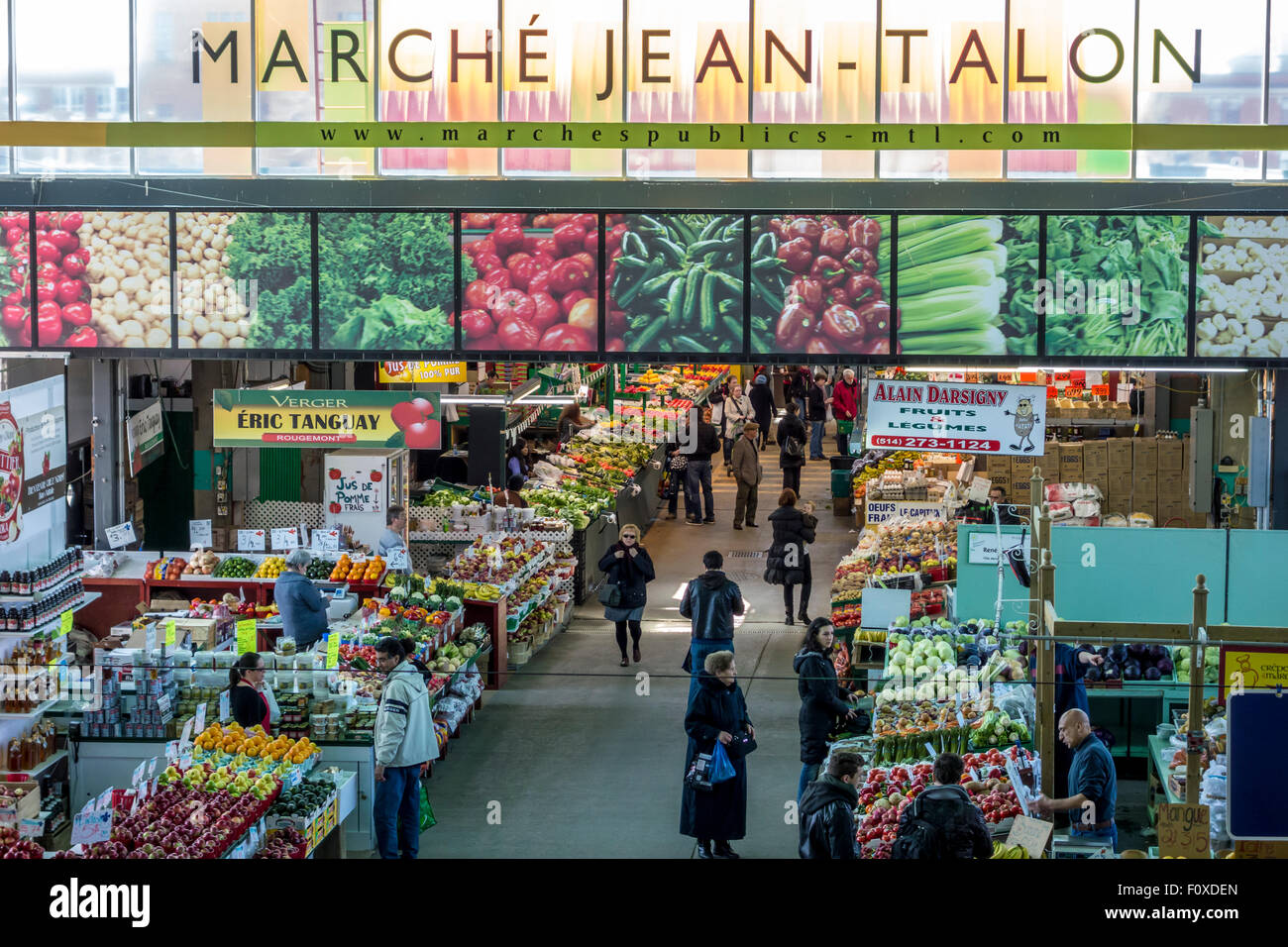People buy groceries at Jean-Talon Market, the largest outdoor public market in North America. Circa April 2013, Stock Photo