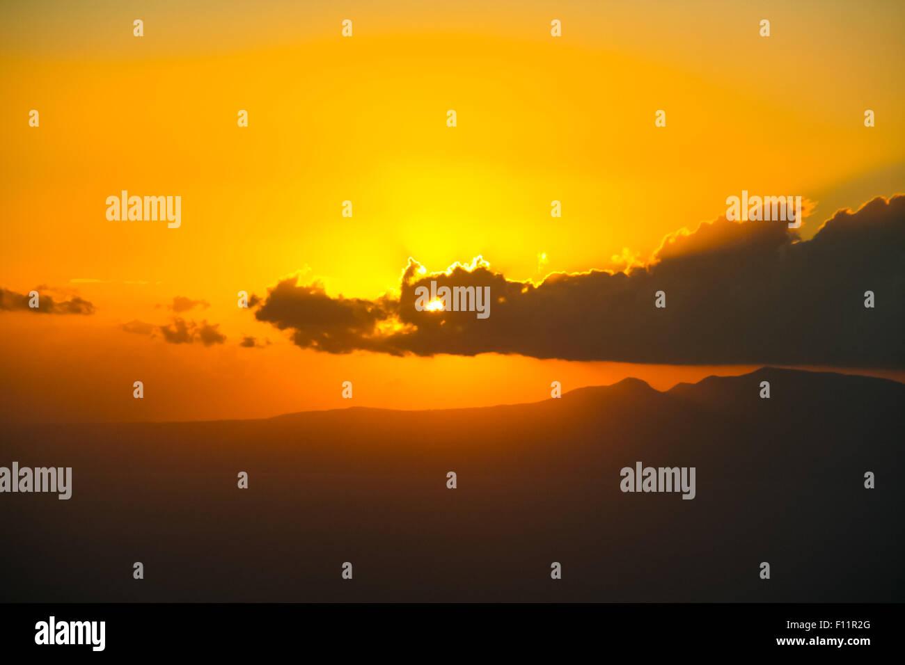 Sun looking like the dragon eye. - Stock Image