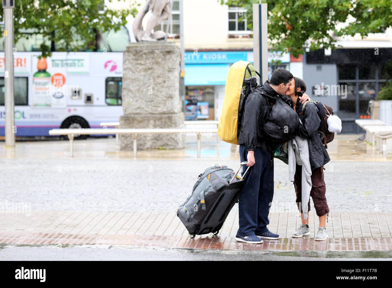 a-couple-kissing-goodbye-on-a-wet-rainy-