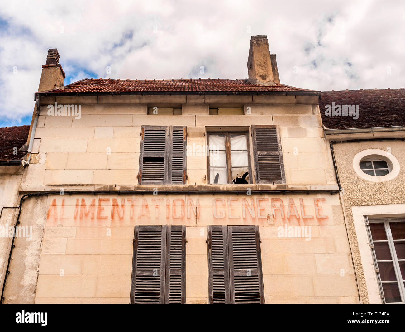 Old faded shop signs, Yonne, France. - Stock Image