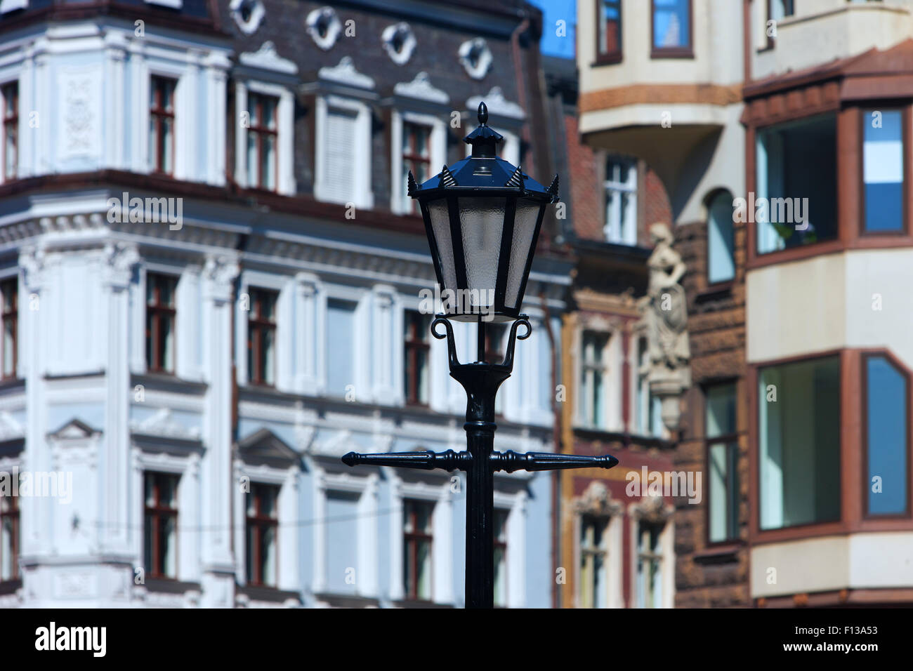 Latvia, Riga. Street lamp on the background of the facades of old houses of the old town on a sunny day at the Dome - Stock Image