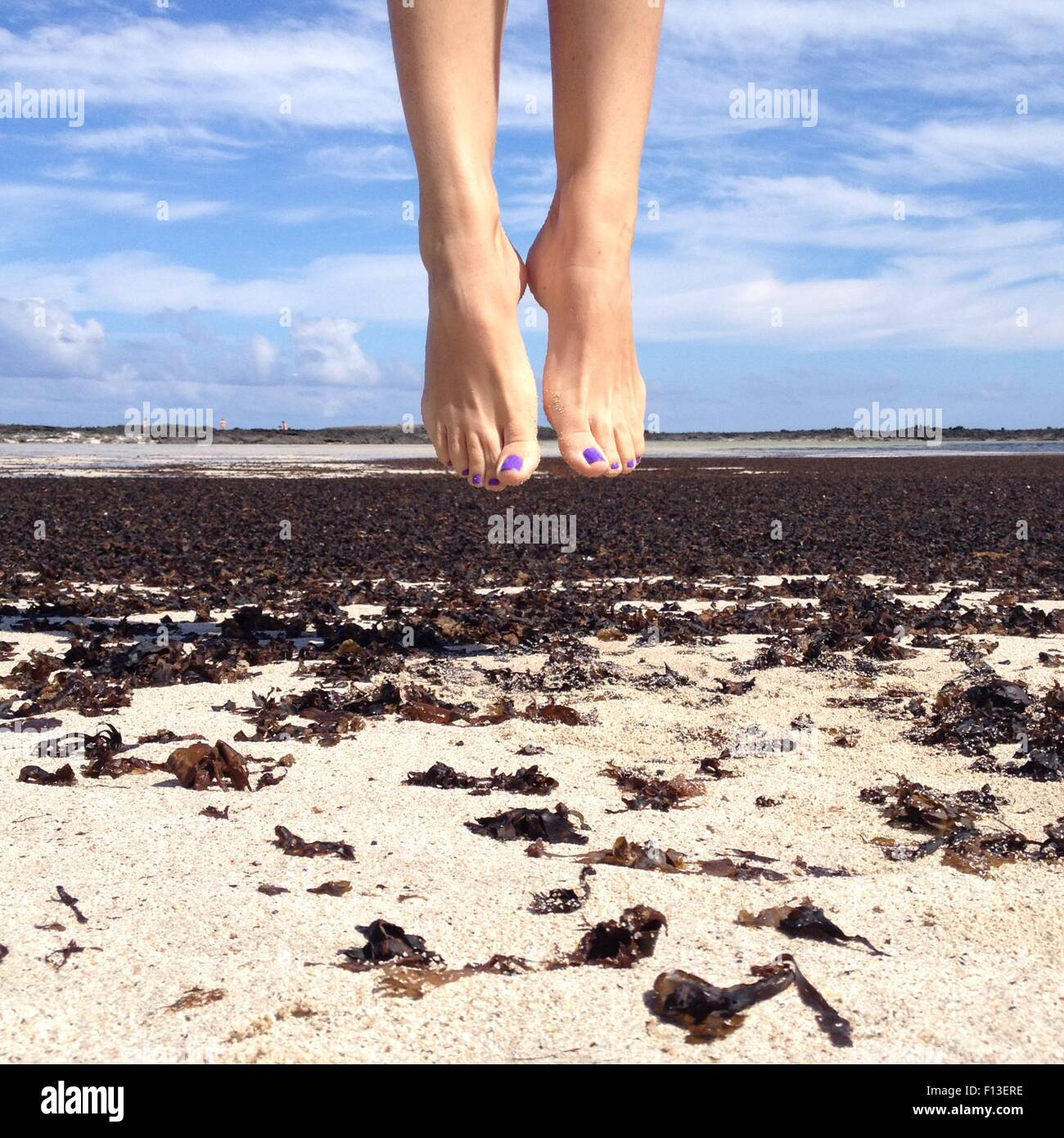 Human feet in mid air - Stock Image