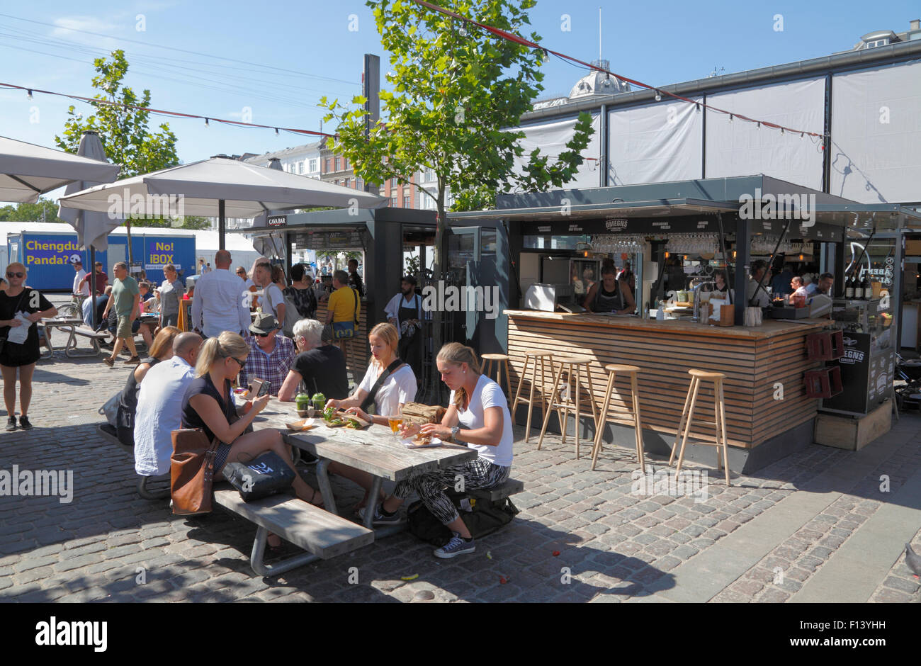 Refreshments at Torvehallerne, the covered food market at Israels Plads in Copenhagen on a sunny summer Saturday Stock Photo