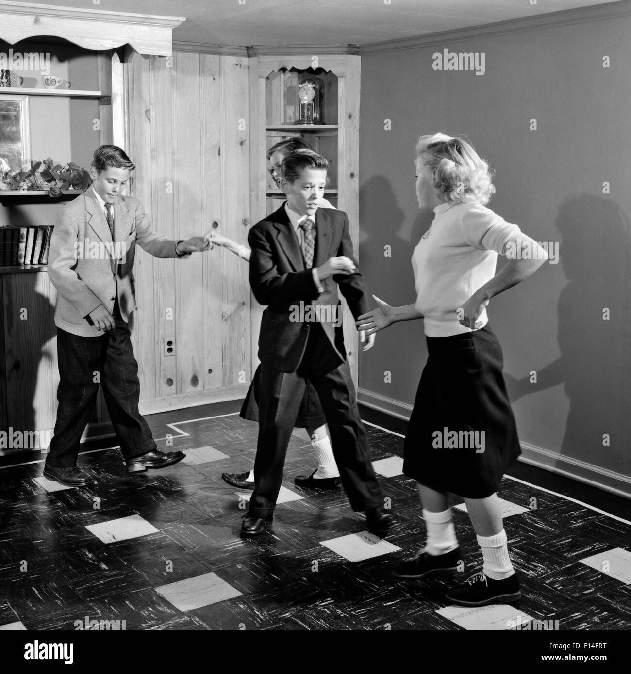 1950s FOUR TEENAGE BOYS AND GIRLS DANCING PARTY Stock ...