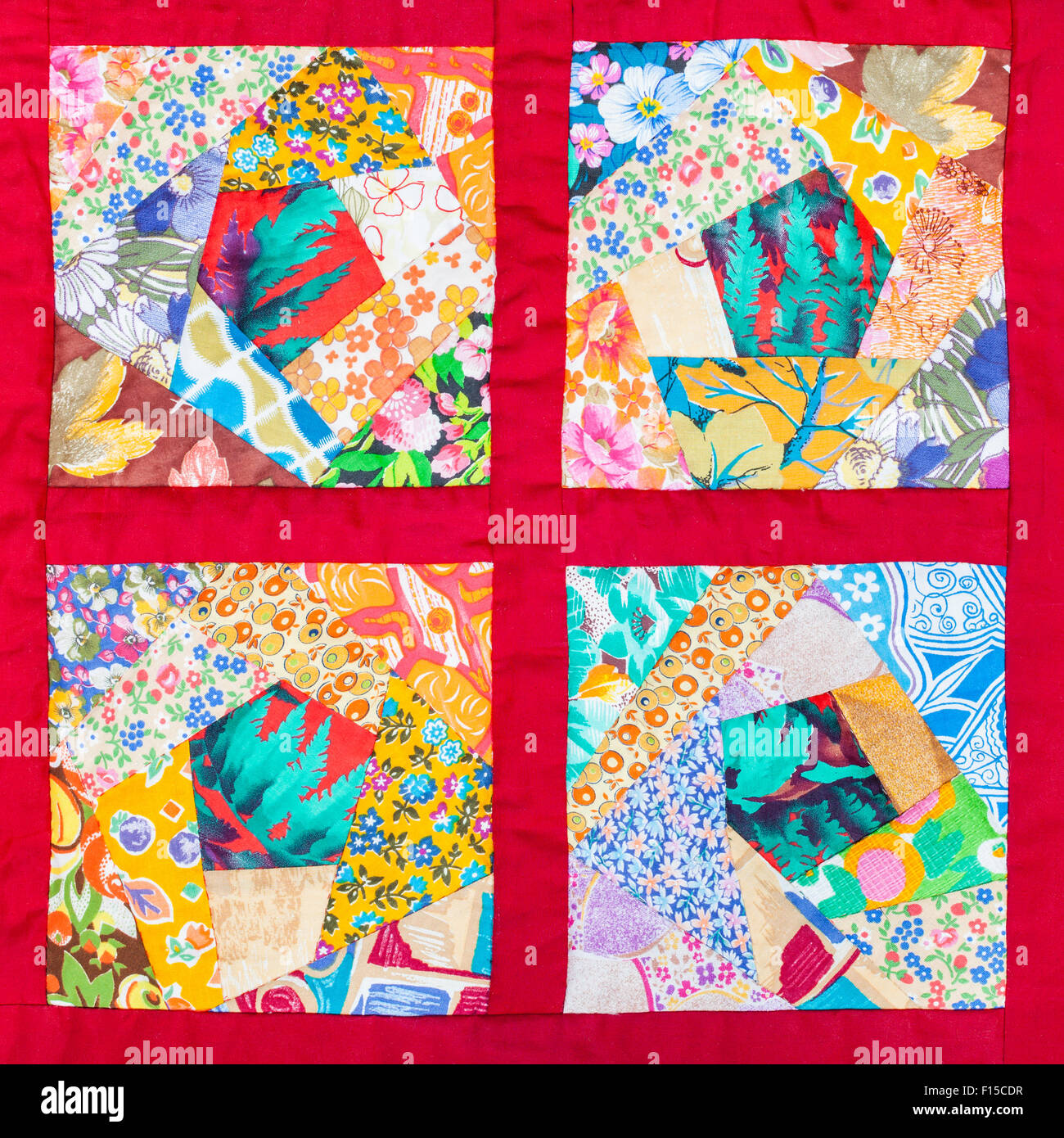 four details of hand made patchwork quilt in red fabric framing ...