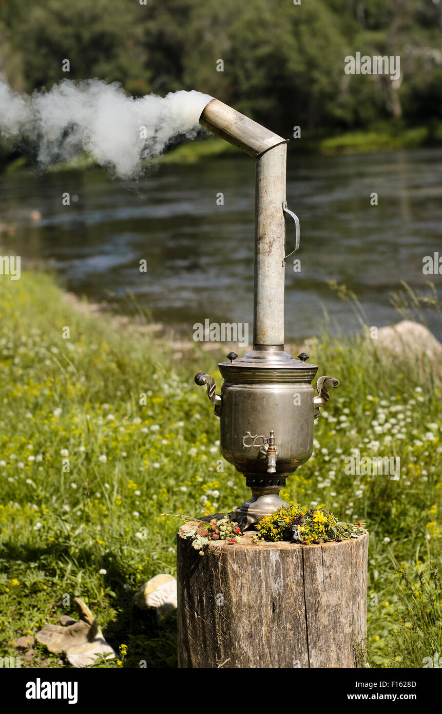 iron, antique russian samovar to boil on nature, vertical photo - Stock Image