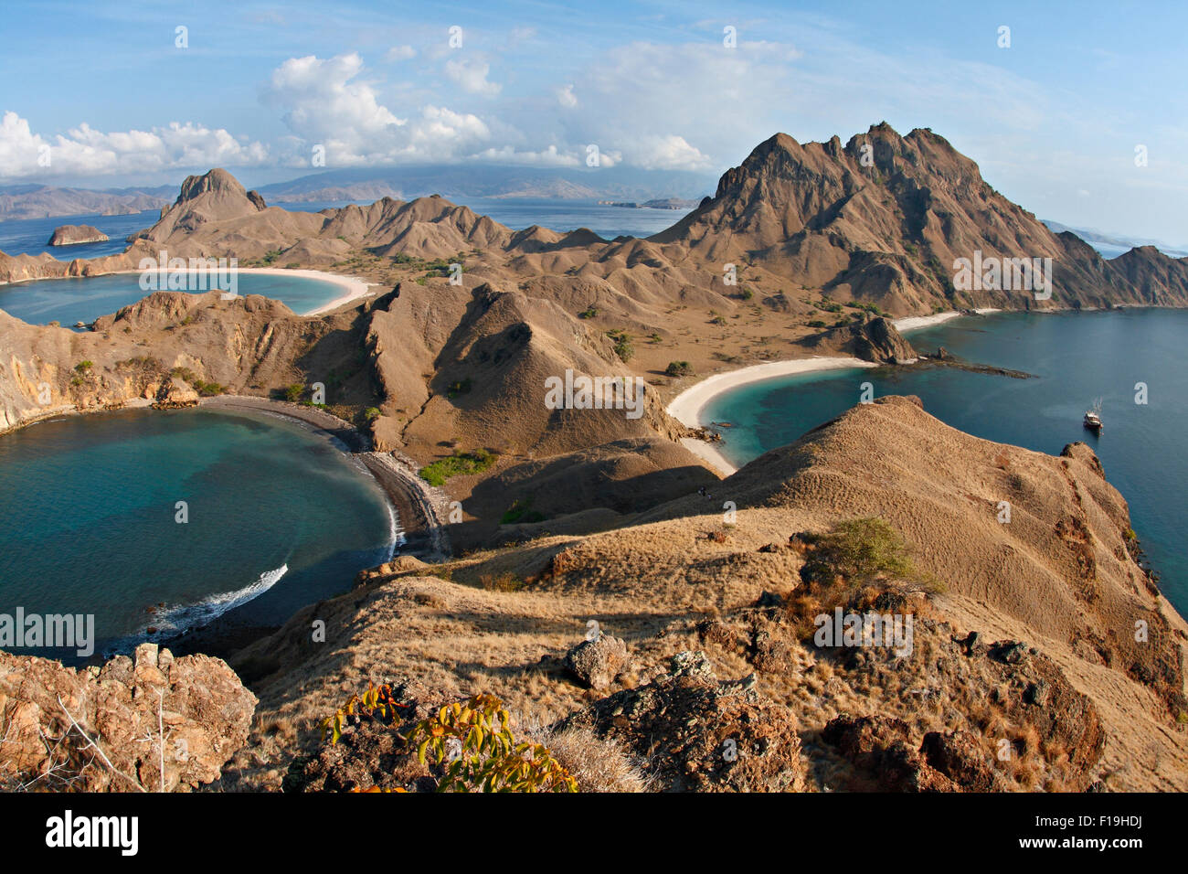 """px91466-D. amazing view from atop Padar Island, Komodo National Park. Dive boat """"Seven Seas"""" in bay. Indonesia, Stock Photo"""