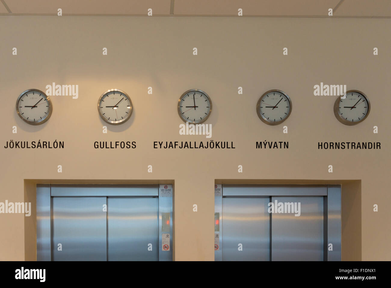 Clocks in the hotel lobby of Hotel Klettur in ReykjavikStock Photo