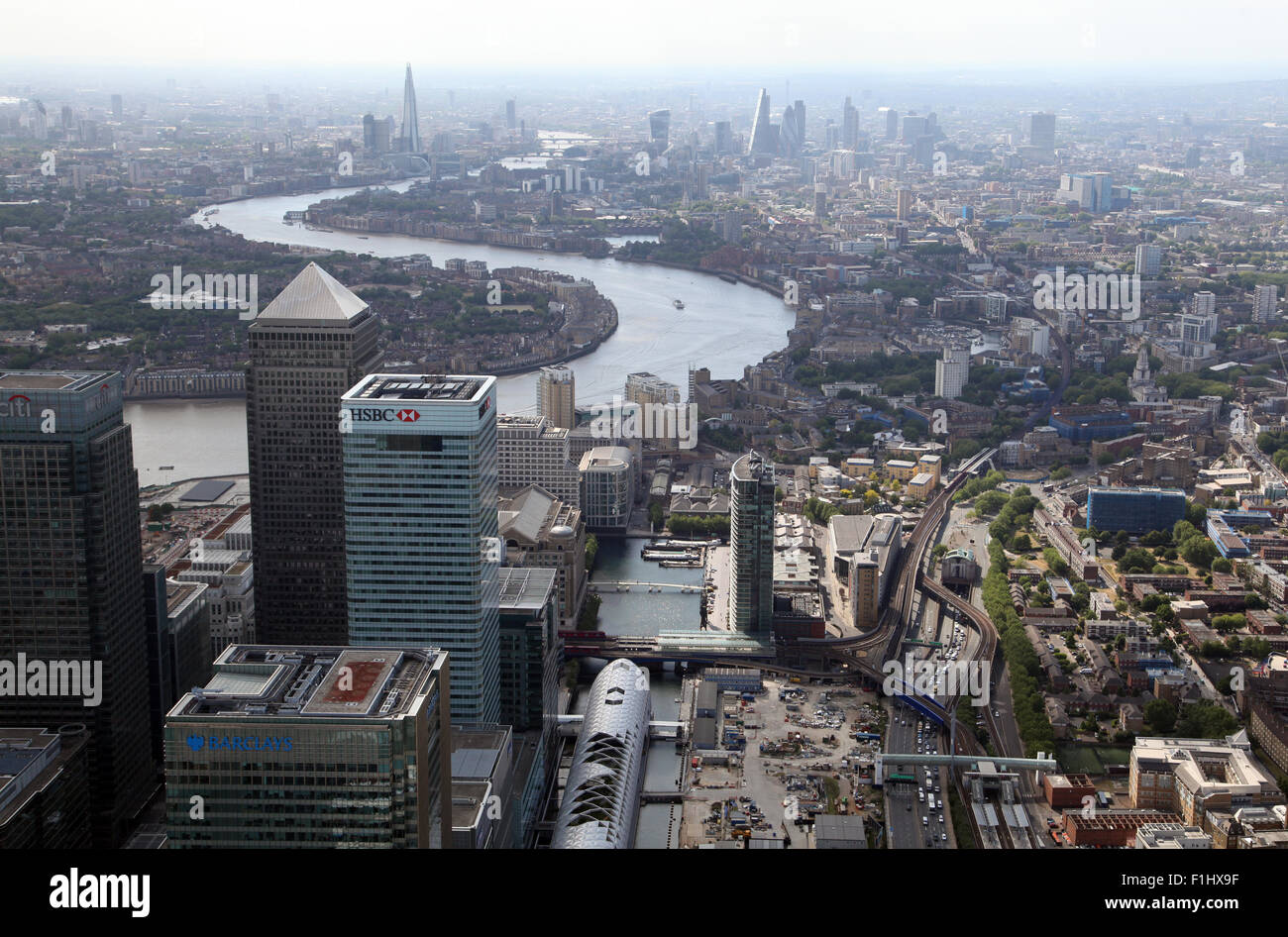 aerial view of Canary Wharf, Docklands & River Thames towards the central London skyline, UK - Stock Image