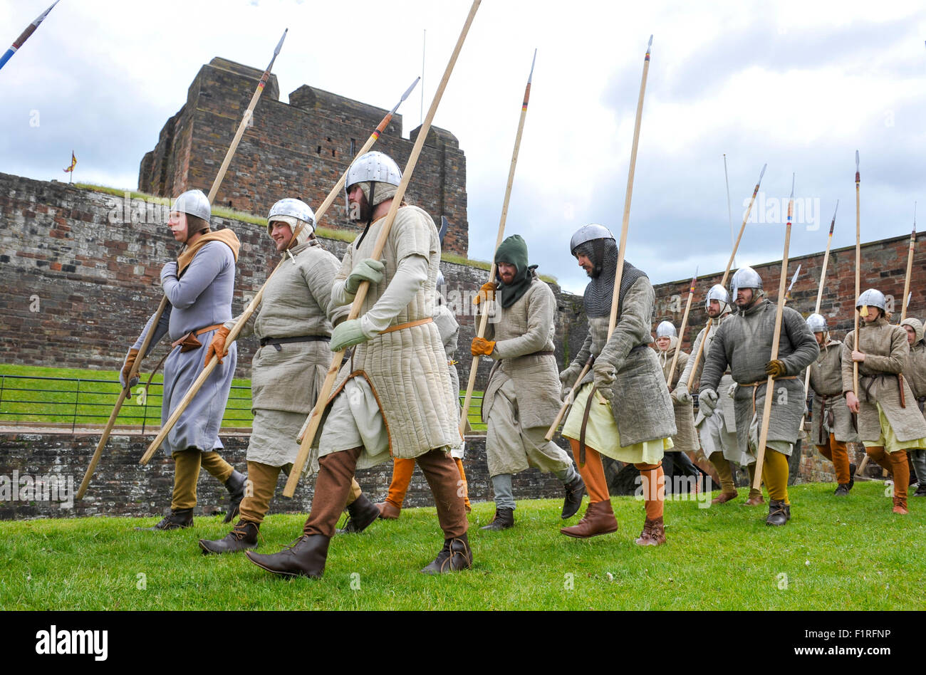Reenactors mark 700 years since the Scots led by Robert The Bruce laid siege to the English of Carlisle Castle - Stock Image