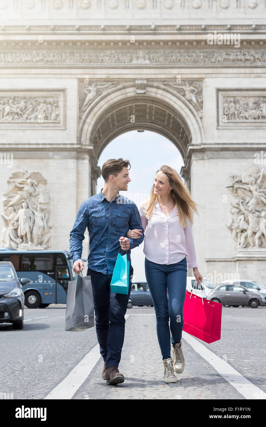 Couple shopping on Avenue des Champs Elysees - Stock Image