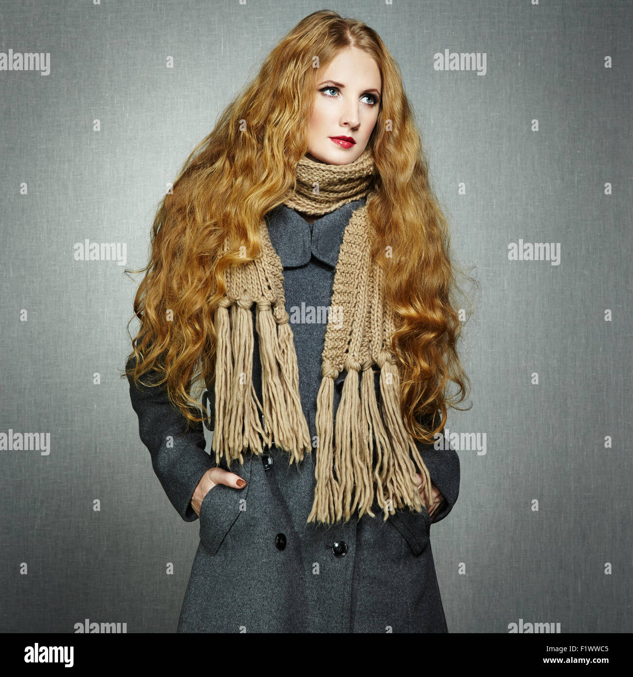 Portrait of young woman in autumn coat. Fashion photo - Stock Image
