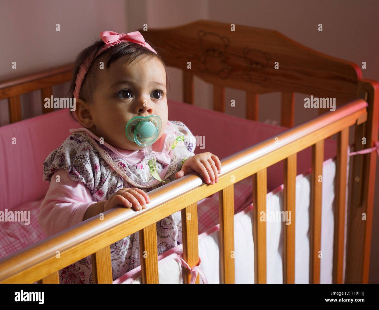 baby girl with pacifier inside crib stock photo 87249502 alamy