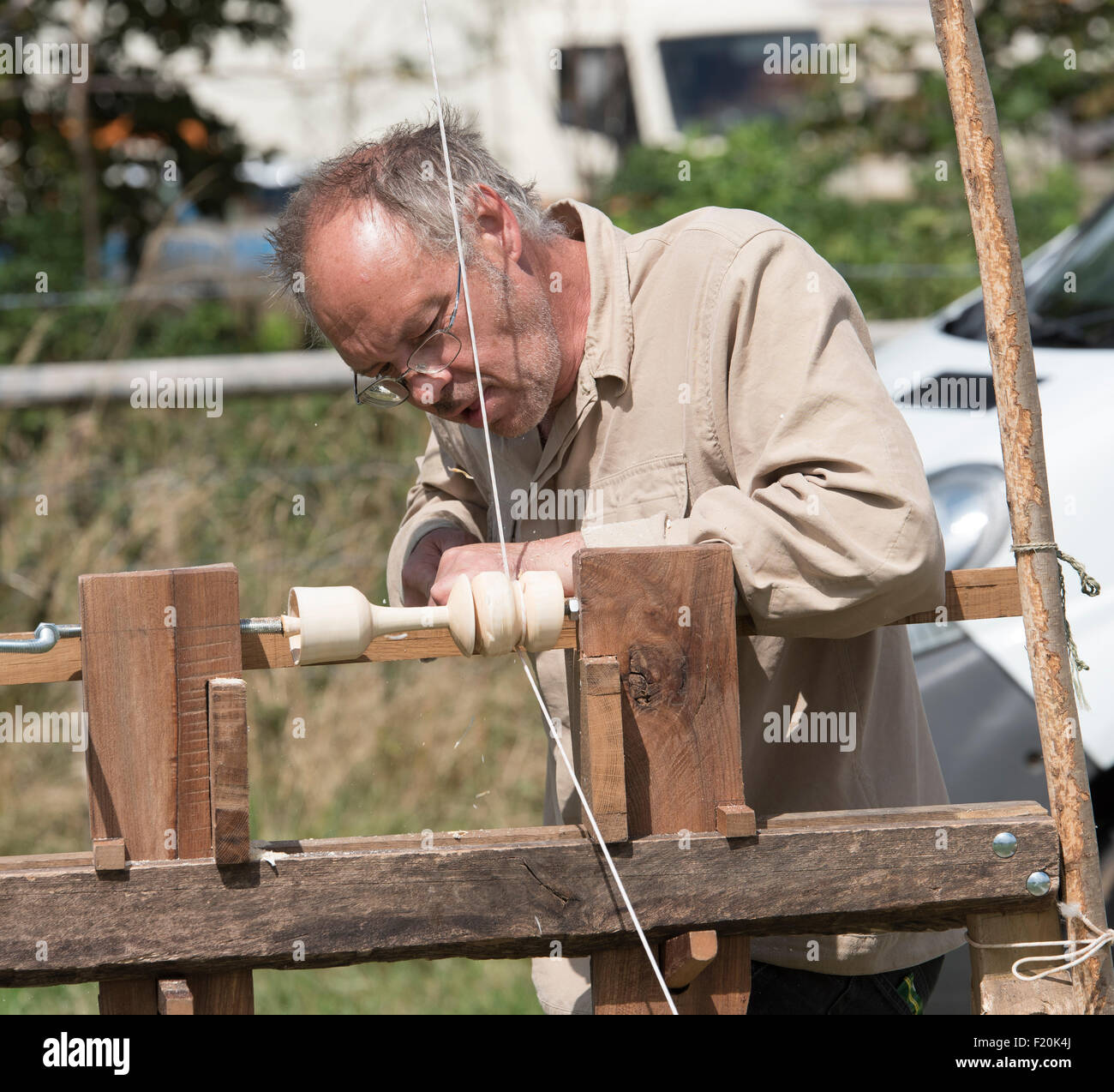 Wood turning demonstration at Steam rally and Country fair Stow cum Quy Cambridgeshire England 2015 Stock Photo