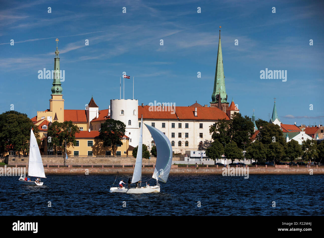 Latvia, Riga - august, 14.The yacht with a sail at the triangle cable-stayed bridge in Riga on the background of - Stock Image