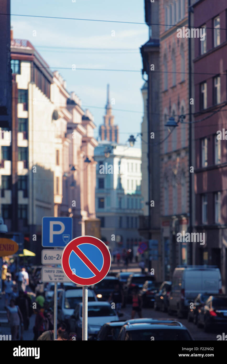 Road sign parking is prohibited on a busy street in Riga with high historical houses - Stock Image