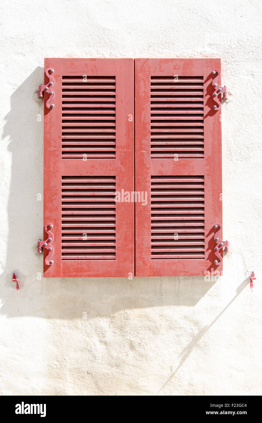 Red shutters on a white background, south of france Stock Photo ...