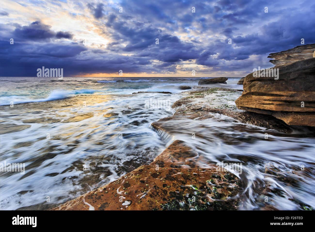 Picturesque pacific coastline at sunrise near Maroubra beach in Sydney - Stock Image