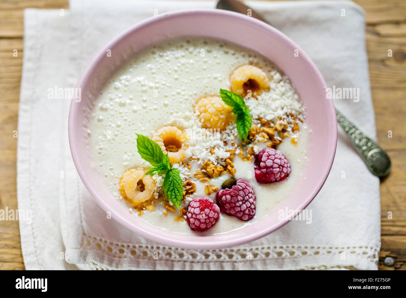Breakfast smoothie with raspberries and granola - Stock Image