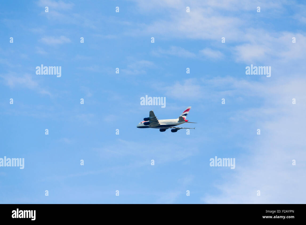 British Airways Airbus A380 flying over Windsor out of London Heathrow, England, UK - Stock Image