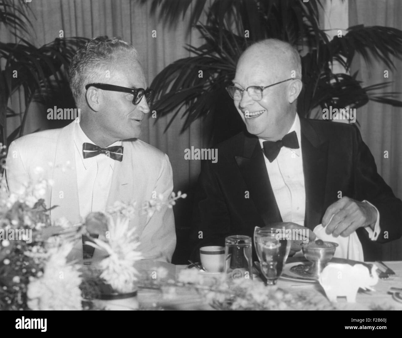 President Eisenhower with Arizona Senator Barry Goldwater. They talk at a testimonial dinner to honor Republicans - Stock Image