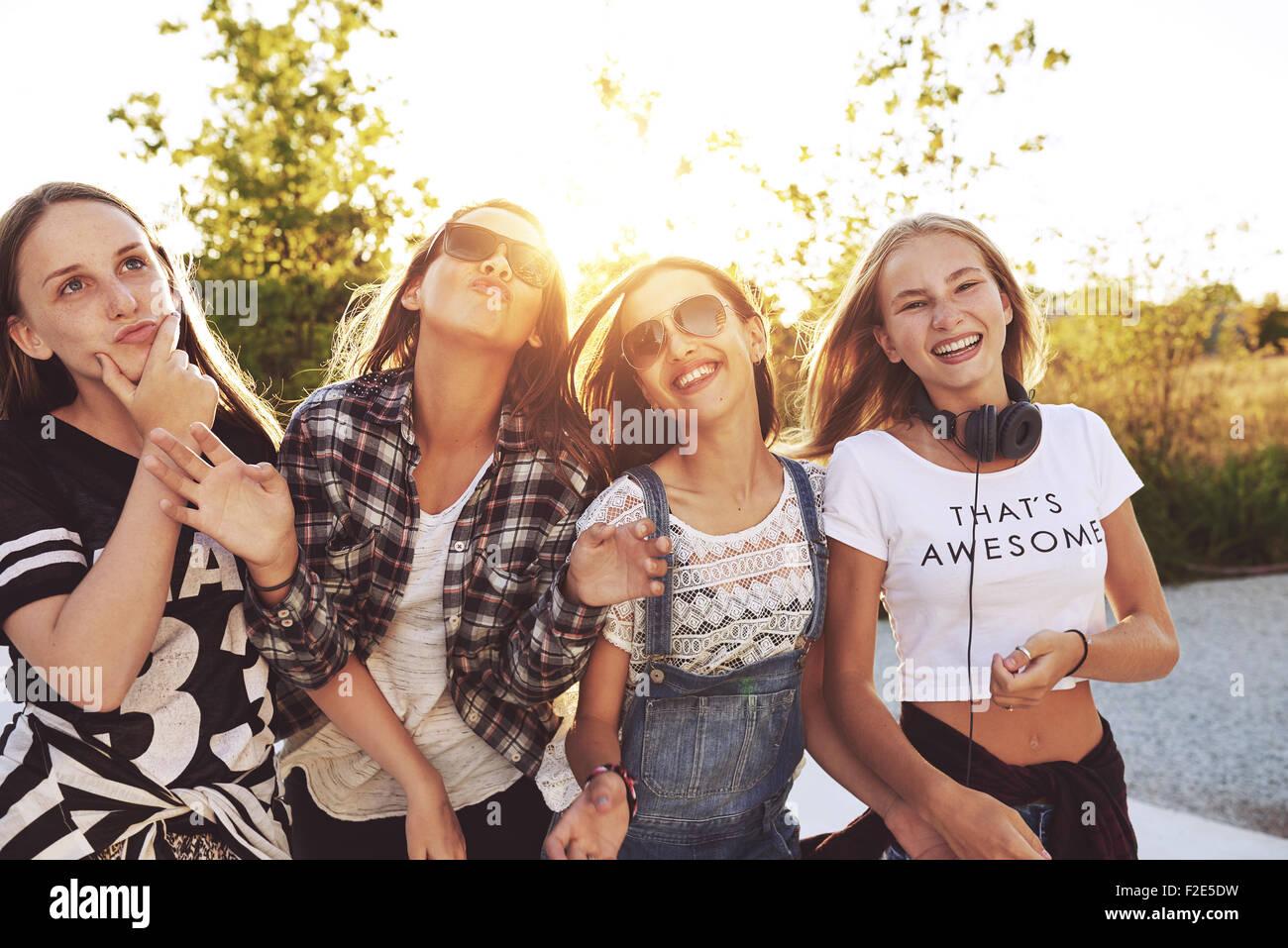 Teenagers having fun on a summer day, sun flare - Stock Image