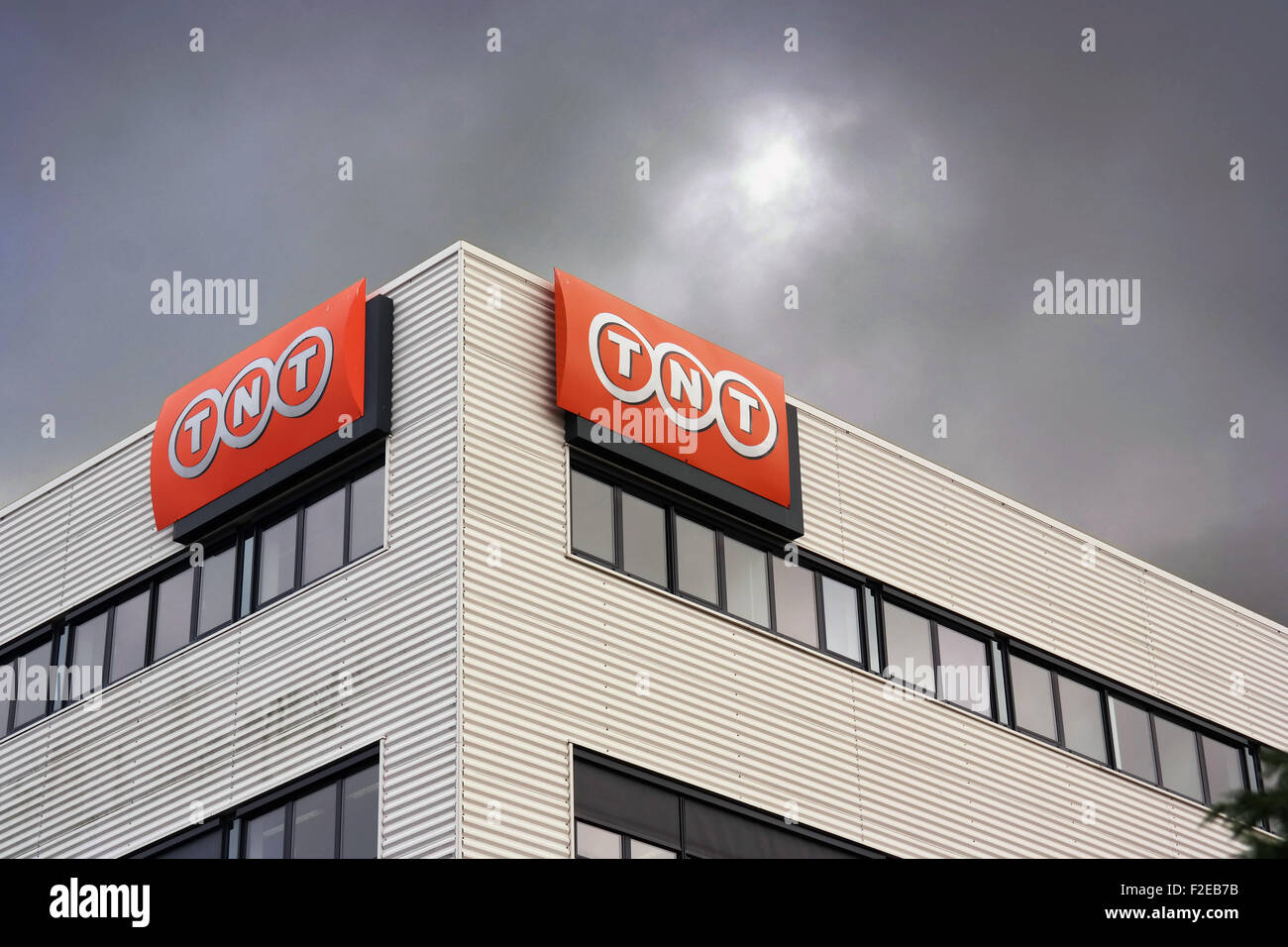 TNT logo on building in Nieuwegein, Netherlands. TNT Express N.V. is an international courier delivery services - Stock Image