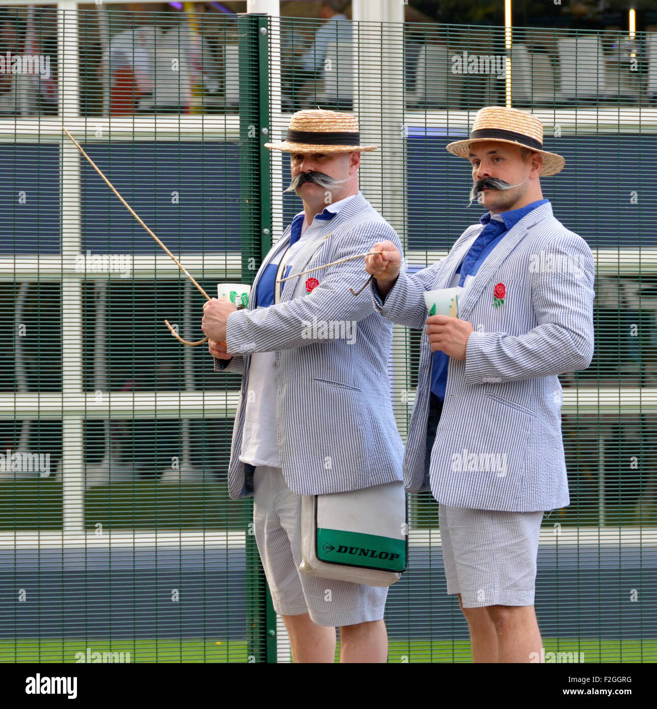 England supporters in regatta schoolboy dress with boater hats arriving for the kick off of the Rugby World Cup - Stock Image