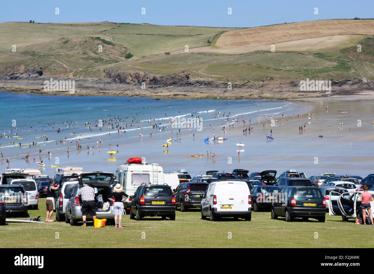 North Cornwall - Polzeath cliff top parking - popular location - view to beach and  Pentire Point - brilliant summer Stock Photo