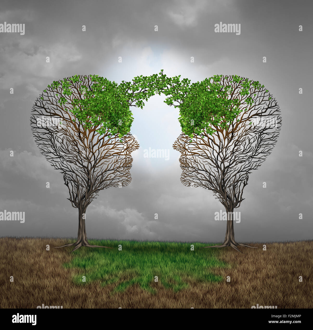 Mutual support and saving one another as a benefit to each other business concept as two sick trees with new leaves - Stock Image