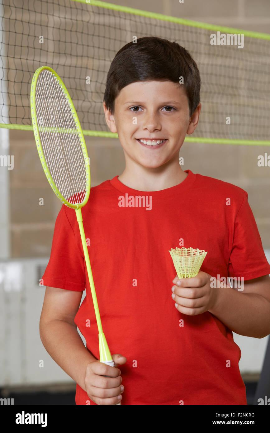 Portrait Of Boy In School Gym Playing Badminton - Stock Image