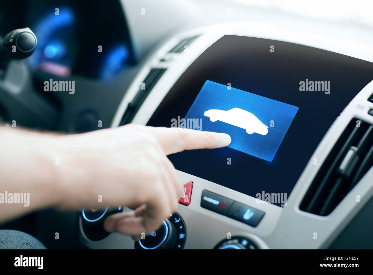male hand pointing finger to car icon on panel - Stock Image