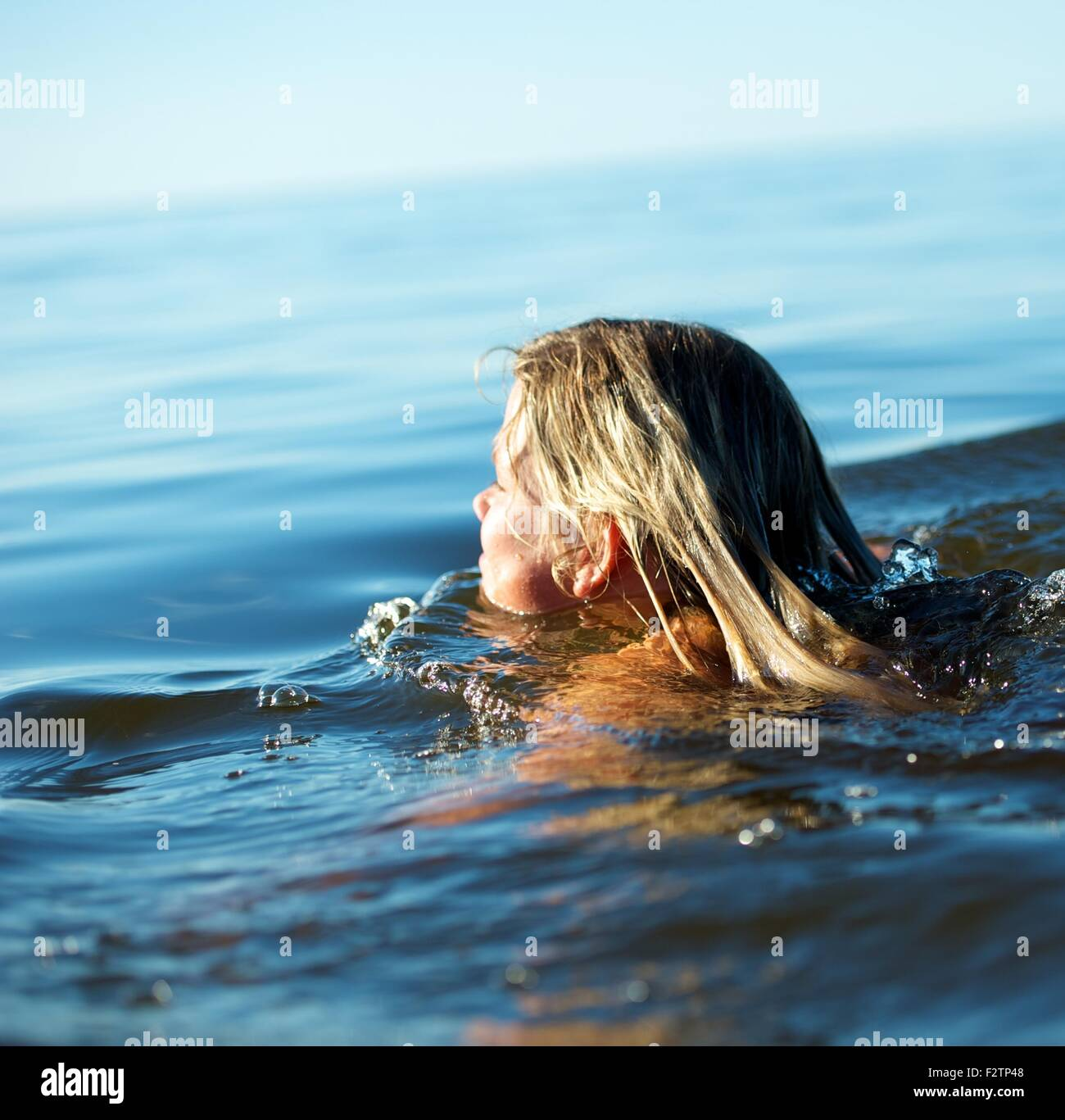 Girl swimming in the water - Stock Image