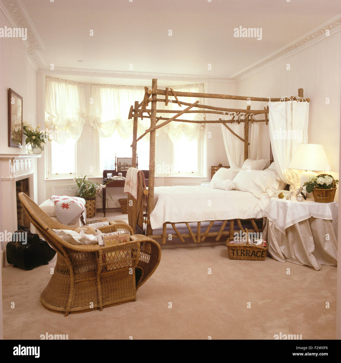 Cane Chair In Nineties Bedroom With Rustic Wooden Four Poster Bed