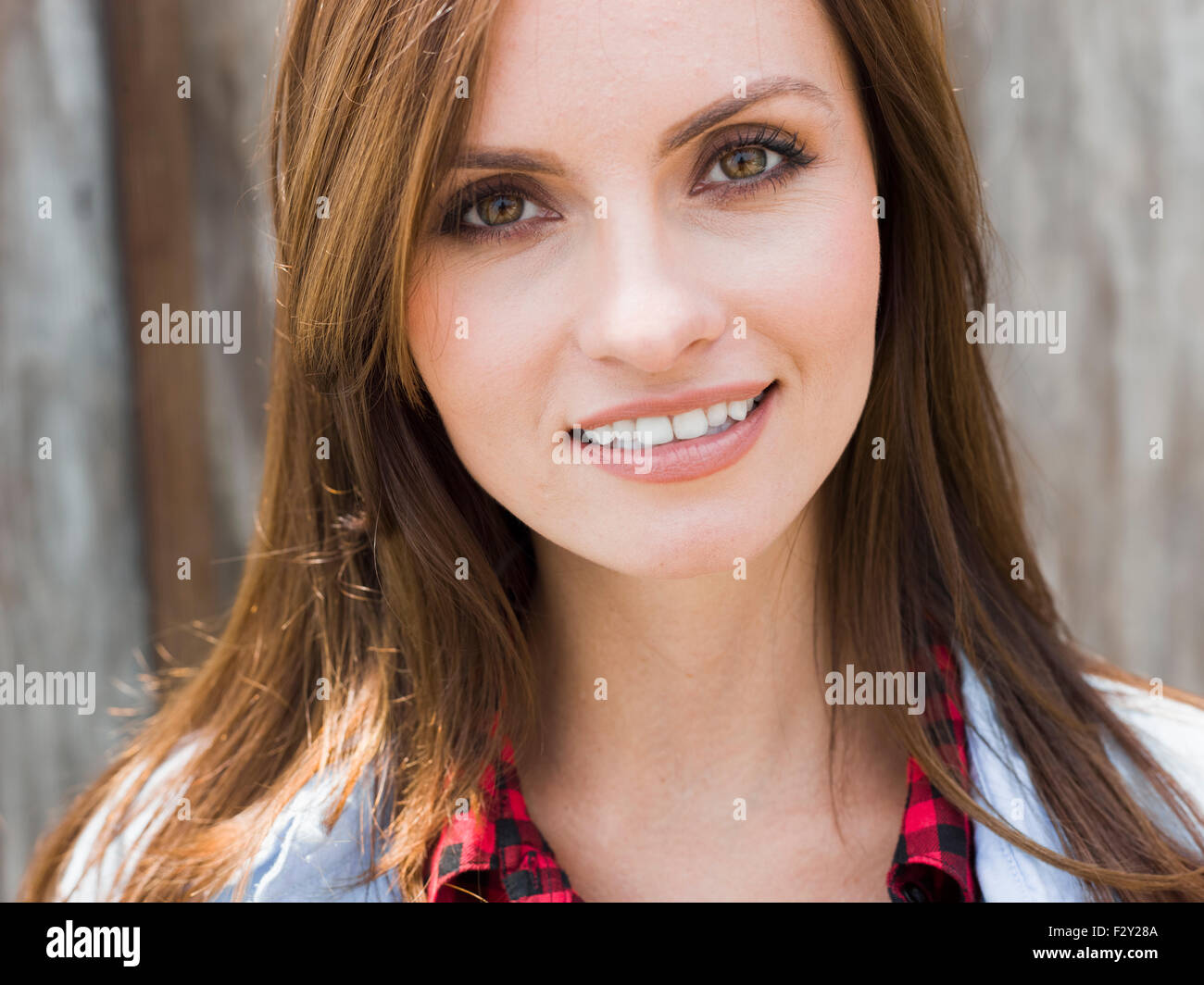 A beautiful woman with brown eyes and brown hair. - Stock Image