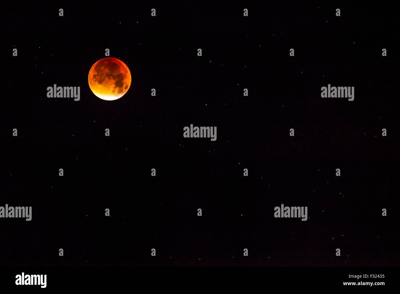 The supermoon Blood Moon over Avebury in Wiltshire, England, UK taken on the 28th September 2015. - Stock Image