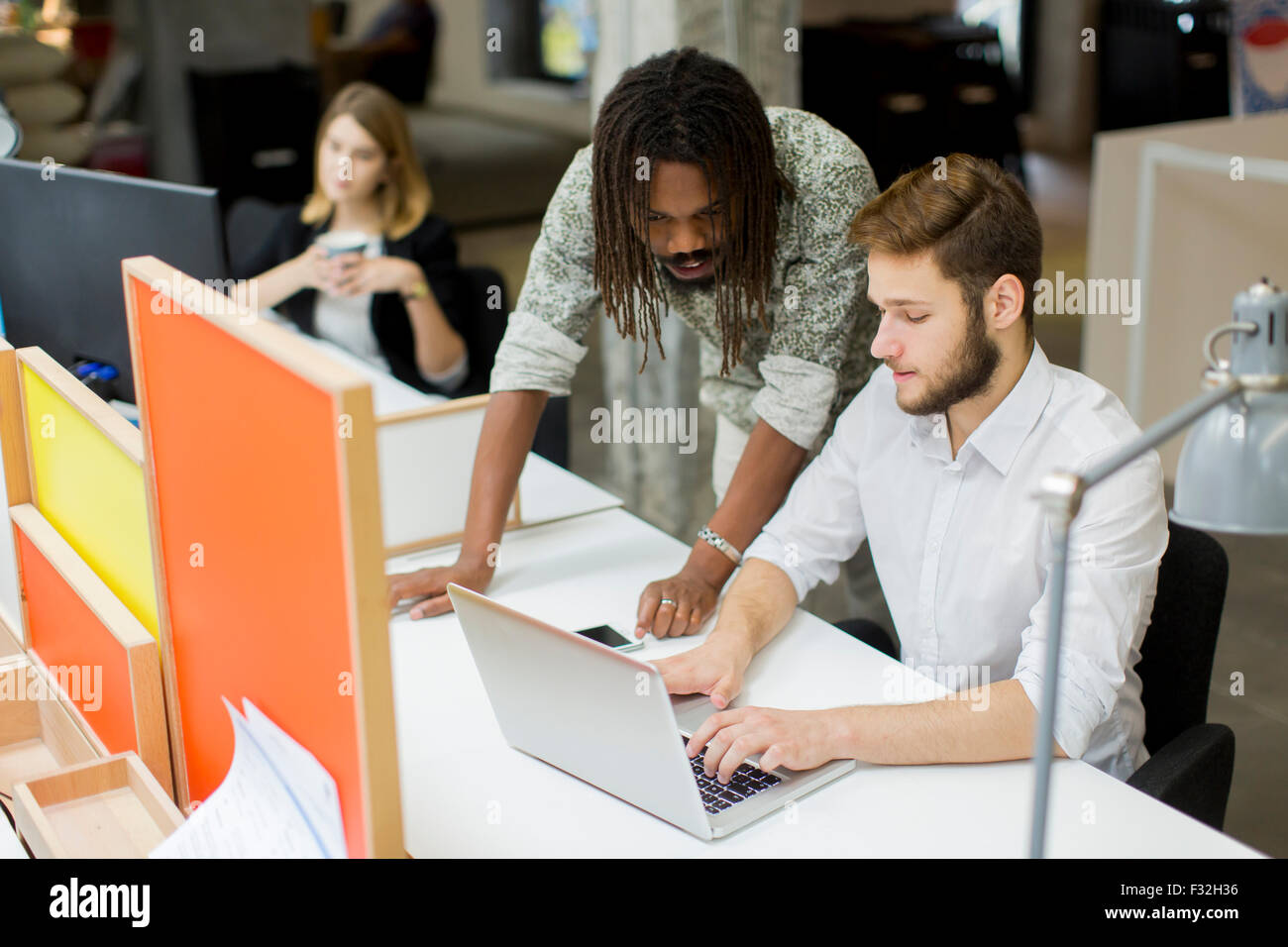 Young people in the office - Stock Image