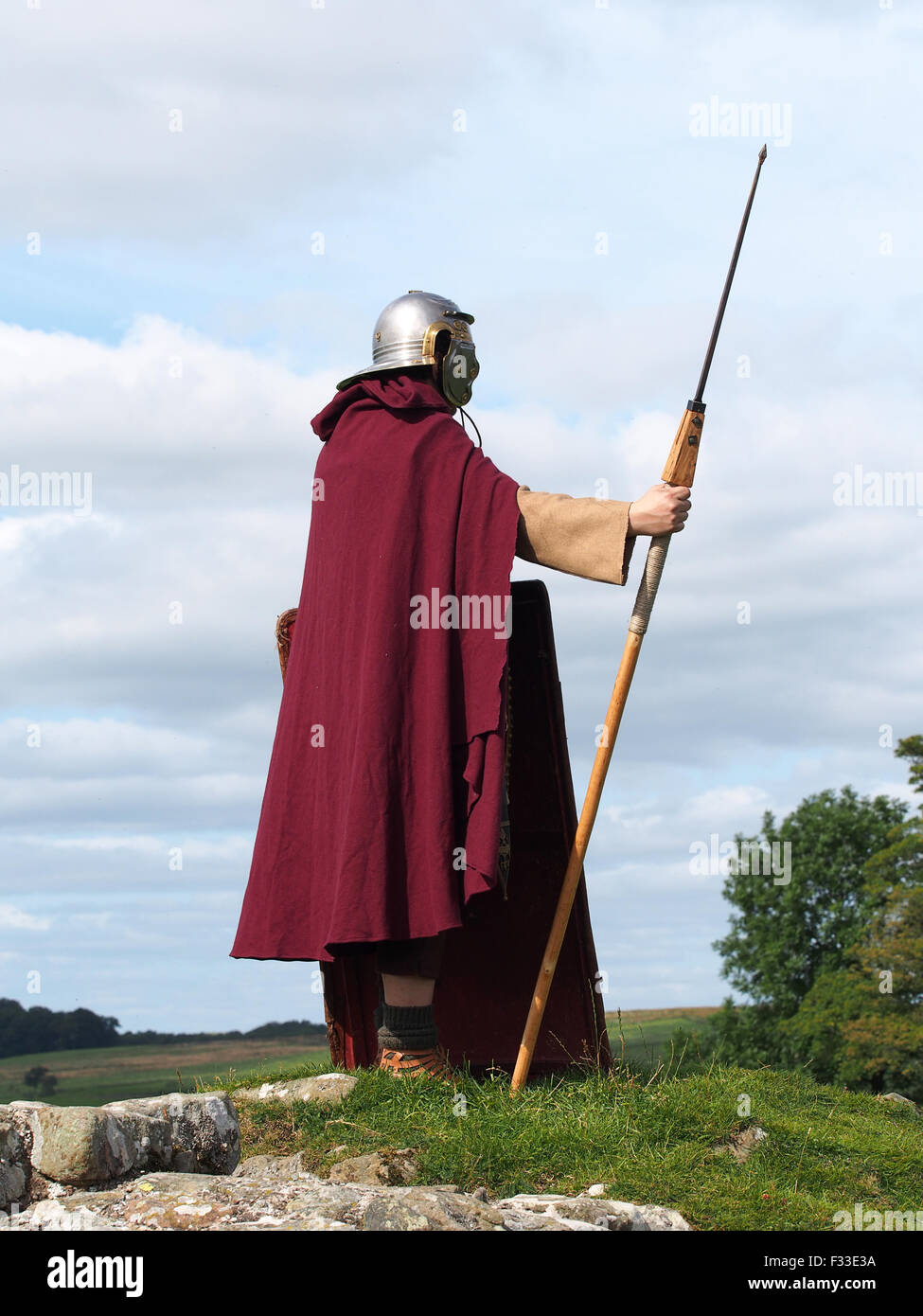 "A member of the Italian group ""Legio I Italica"" stands guard during a re-enactment event on Hadrian's Wall in northern Stock Photo"