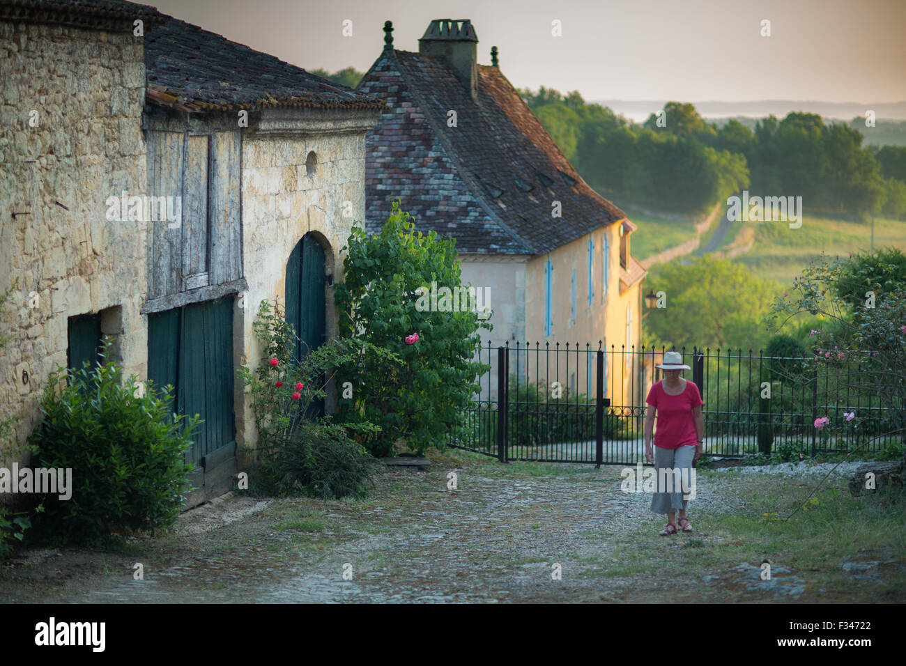 Wendy walking in a lane in Molières, Pays de Bergerac, Périgord, Dordogne, Aquitaine, France - Stock Image