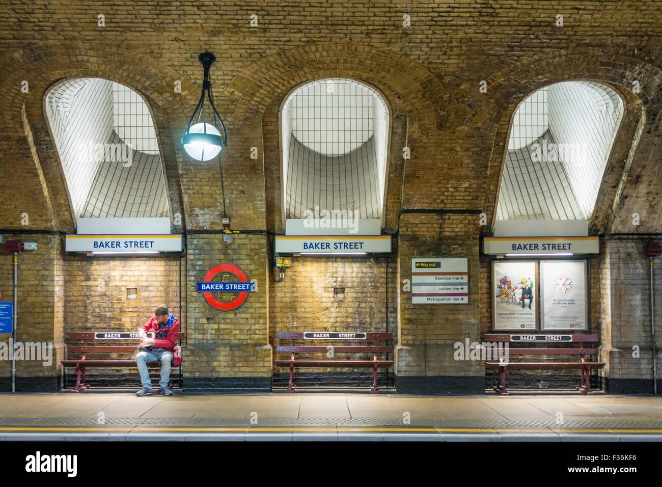 man waiting for a tube train at Baker Street underground station platform London England UK Gb EU Europe - Stock Image