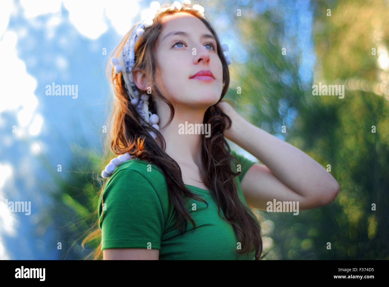 beautiful girl with blue eyes looking at the sky - Stock Image