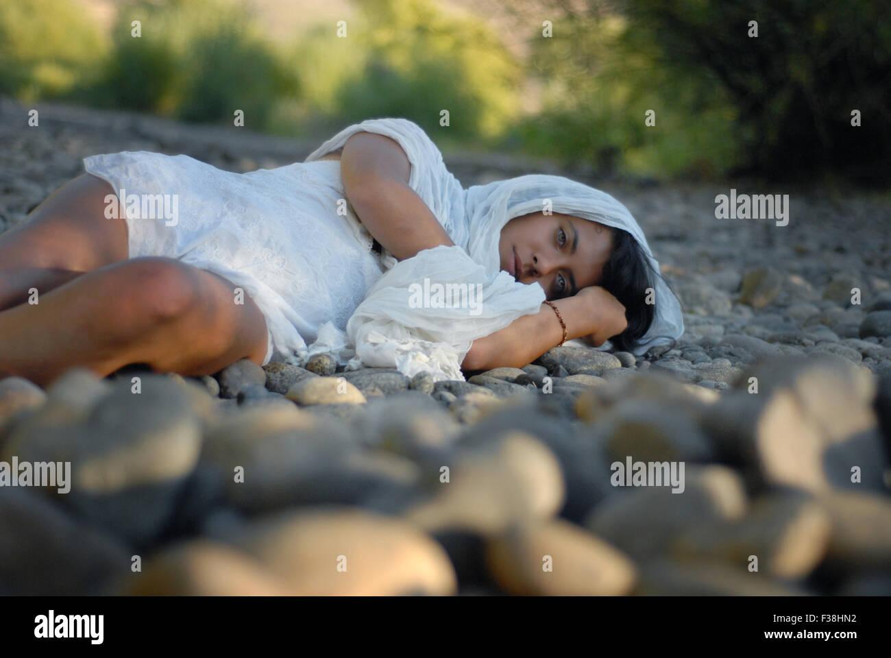 Exotic girl Arabian look like green eyes laying down on the floor - Stock Image