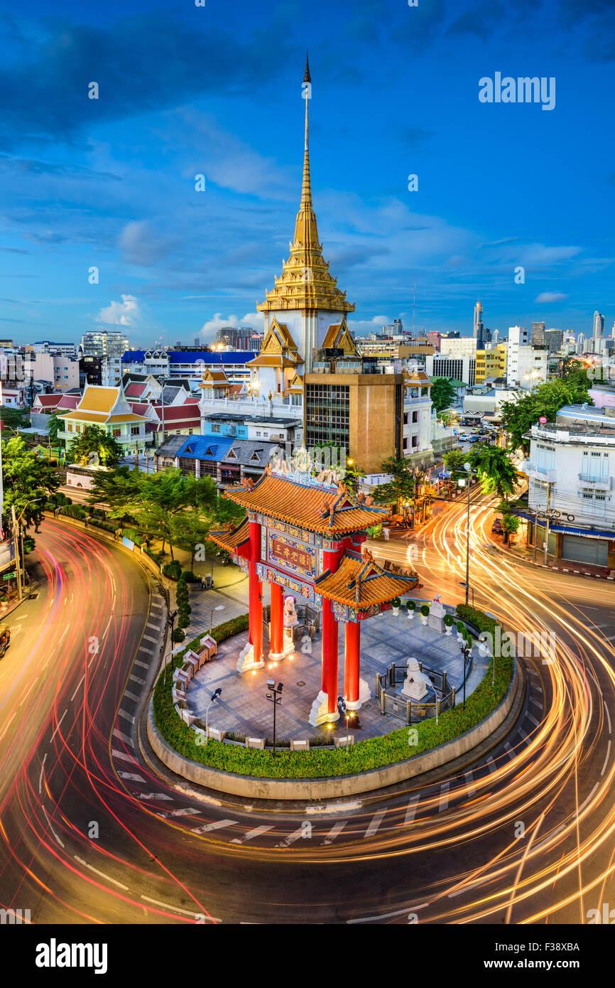 Bangkok, Thailand at Chinatown's traffic circle and Wat Traimit. - Stock Image