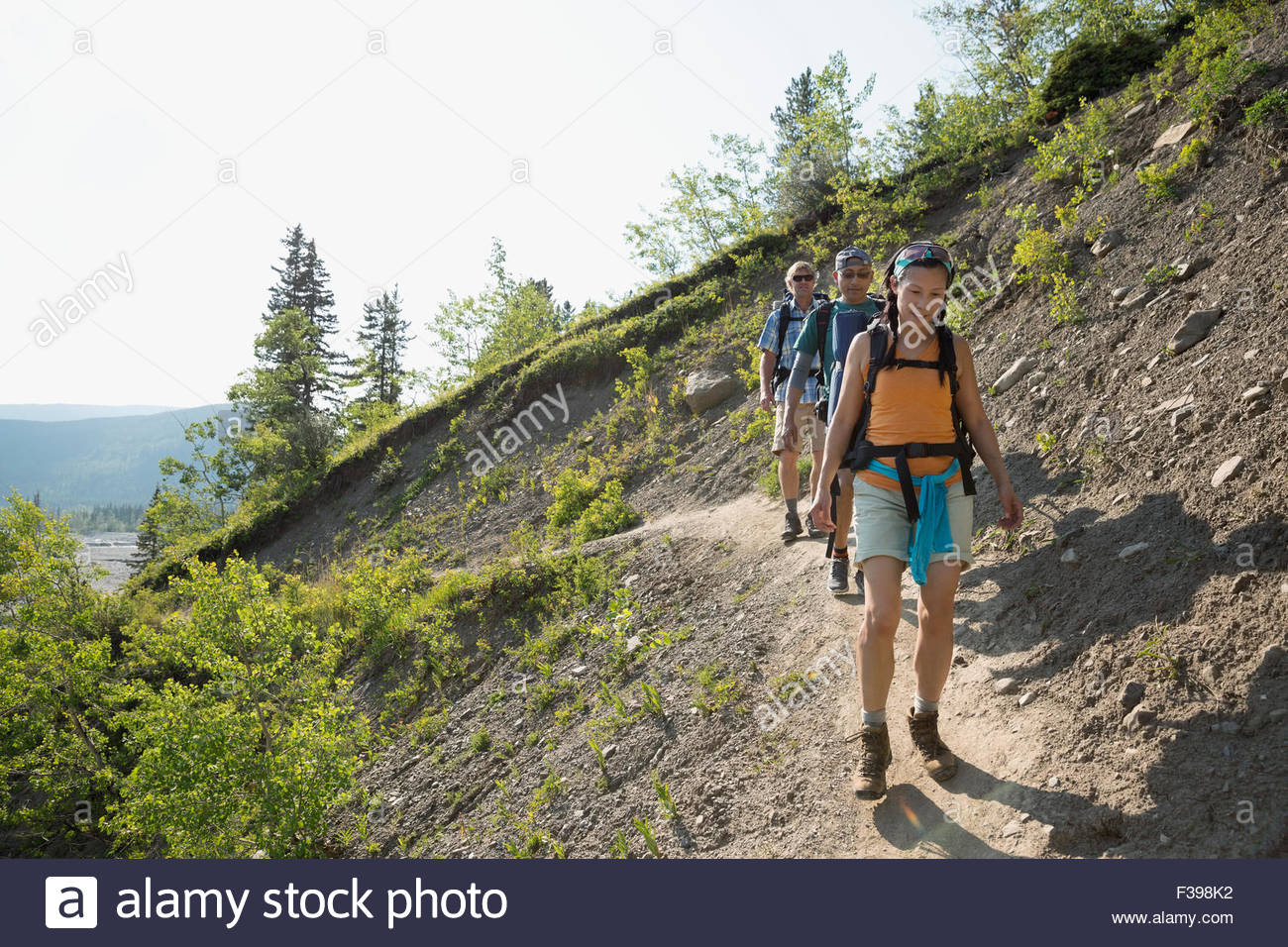 Friends hiking on craggy ridge trail - Stock Image