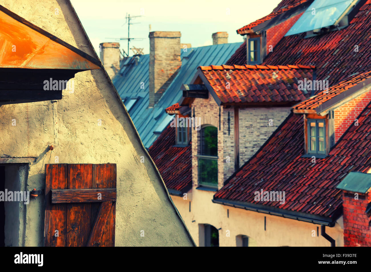 Latvia. Facade of the hangar with doors and red tiled roof with windows and chimneys in the Old Town Riga - Stock Image