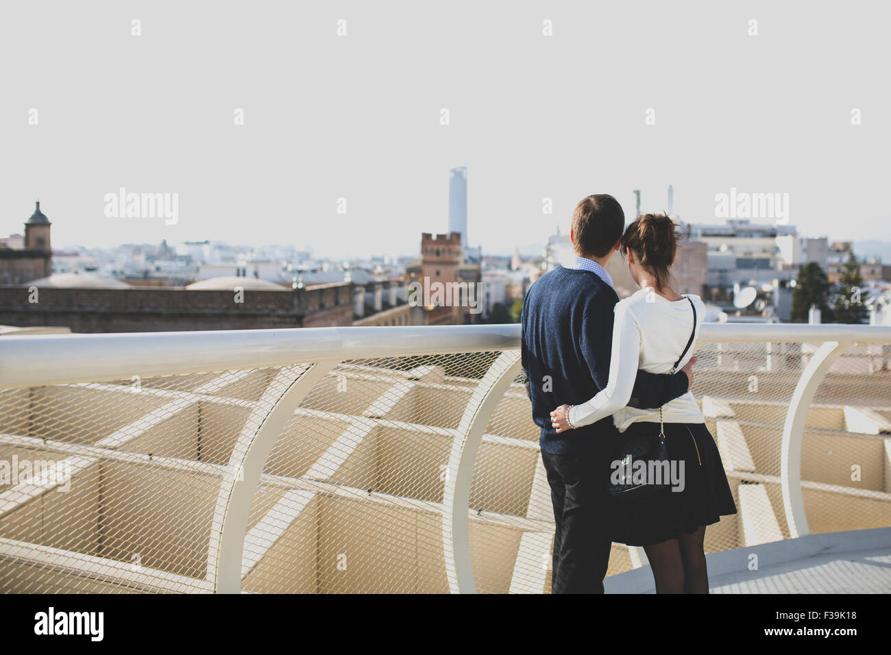 Portrait of a young couple looking at city views, Seville, Andalusia, Spain - Stock Image