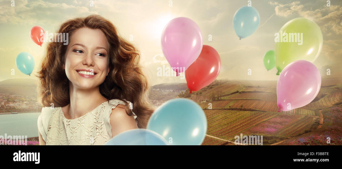 Holiday. Happy Woman with Colorful Air Balloons - Stock Image