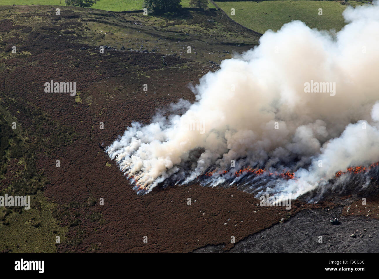 aerial view of stubble burning in northern England, UK - Stock Image