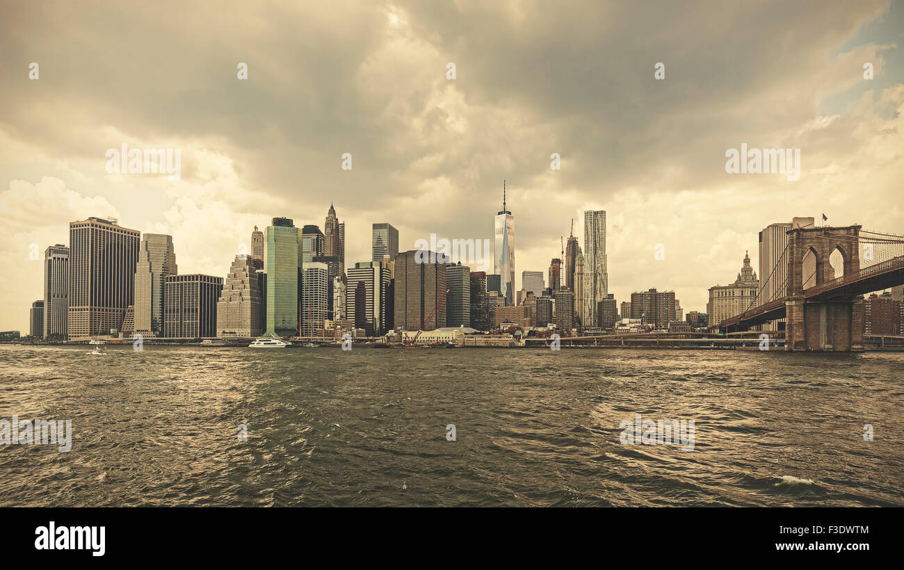 Retro toned stormy sky over Manhattan, NYC, USA. - Stock Image